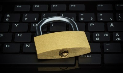 Close-up of a Padlock on a Computer Keyboard by Tuomas_Lehtinen courtesy of FreeDigitalPhotos.net cropped