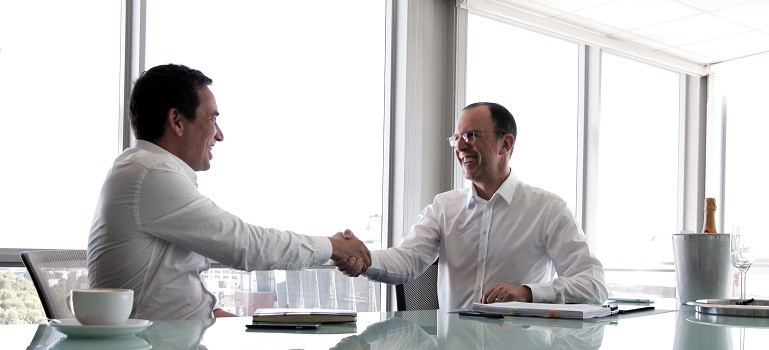 Matthew Buckland and Mike Abel signing the agreement 769 x 449