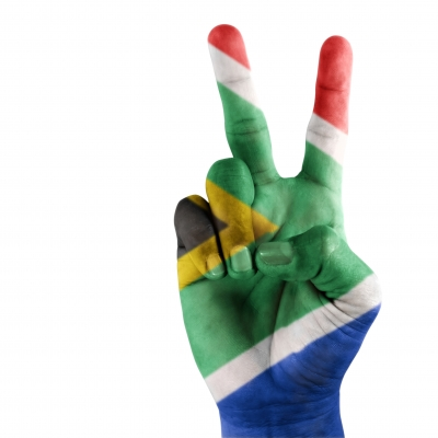 South Africa Flag On Hand by domdeen courtesy of FreeDigitalPhotos.net