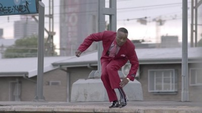 5FM Without 5 TVC screengrab man in red suit