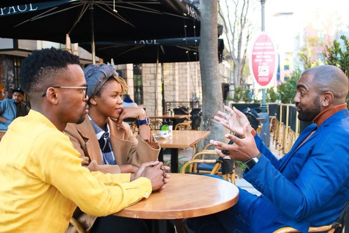 Bradlee Holcomb with a man and a woman at Melrose Arch, June 2019. Pic by Lebogang Tshetlo.