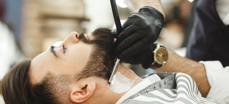 shutterstock hipster being shaved